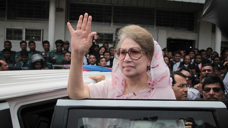 FILE - In this Sunday, April 5, 2015 file photo, former Bangladeshi Prime Minister Khaleda Zia waves as she leaves after a court appearance in Dhaka, Bangladesh. Bangladesh's High Court on Thursday decided Zia can stand trial on corruption charges involving a contract for a coal mine with a Chinese company, lawyers said. (AP Photo/ A.M. Ahad, File)