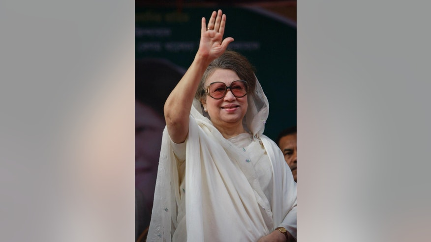 FILE - In this Wednesday, Nov. 28, 2012 file photo, Bangladesh's opposition leader and former prime minister Khaleda Zia waves to supporters at a 18 party alliance meeting in Dhaka, Bangladesh. Bangladesh's High Court on Thursday decided Zia can stand trial on corruption charges involving a contract for a coal mine with a Chinese company, lawyers said. (AP Photo/Pavel Rahman, File)
