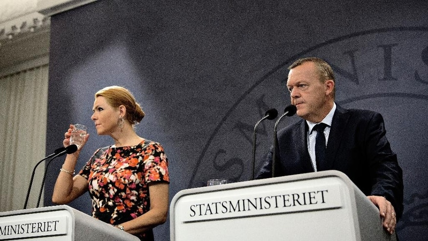 "Denmark's Prime Minister Lars Loekke Rasmussen, right, and Minister of Immigration and Integration Inger Stoejberg, left, attend a press conference Thursday, Sept. 17. 2015 at the Prime Ministers Office in Copenhagen. Rasmussen said Denmark would on ""a voluntarily basis"" be willing to take 1,000 refugees ""in the light of the extraordinary situation"" but won't take part in any mandatory European Union quota to relocate the tens of thousands of migrants pouring into Europe. (Joachim Adrian/Polfoto via AP) DENMARK OUT"