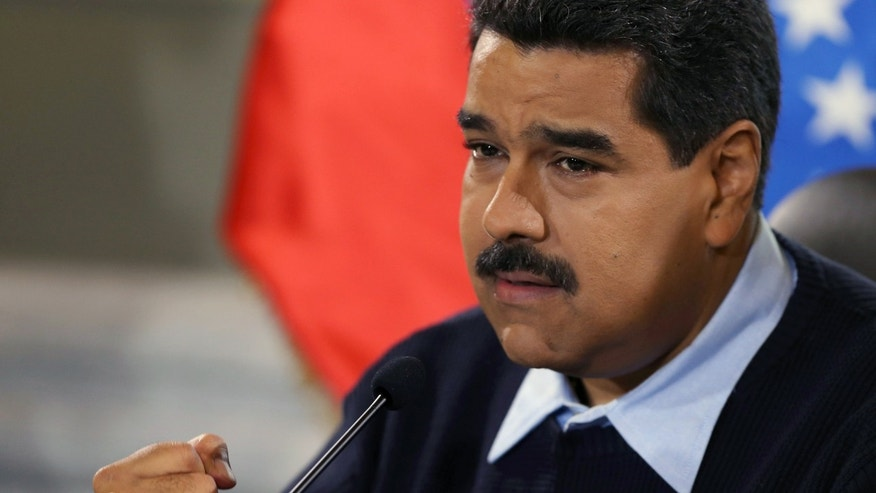 Venezuela's President Nicolas Maduro gestures during a news conference at  Miraflores presidential palace in Caracas, Venezuela, Monday, Aug. 24, 2015. Venezuelan security forces have deported hundreds of Colombians as part of a security offensive along the border that is ratcheting up tensions between the two neighbors.(AP Photo/Fernando Llano)