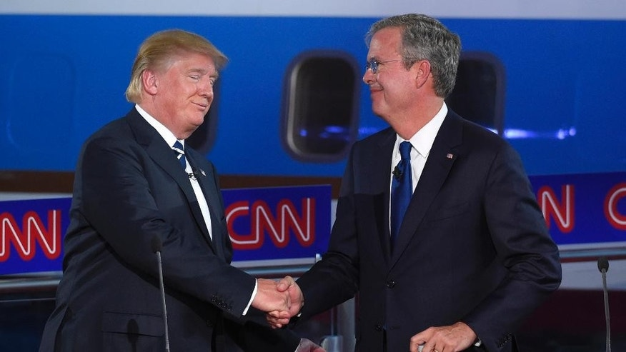 Republican presidential candidates Donald Trump, left, and Jeb Bush shake hands before the CNN Republican presidential debate at the Ronald Reagan Presidential Library and Museum on Wednesday, Sept. 16, 2015, in Simi Valley, Calif. (AP Photo/Mark J. Terrill)