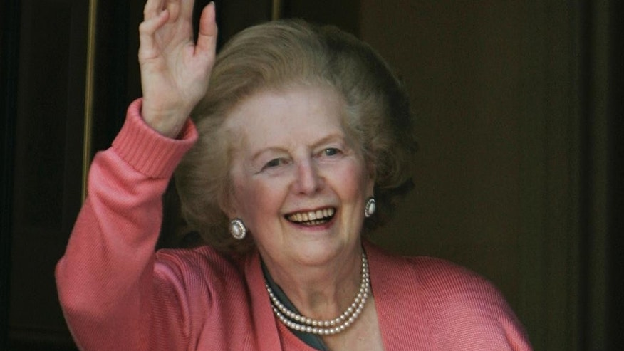 FILE - In this Monday June 29, 2009 file photo, former British Prime Minister Margaret Thatcher waves to members of the media following her return home from hospital suffering from a broken arm, in central London. Britain is abuzz with U.S. presidential candidate Jeb Bush's suggestion that Margaret Thatcher should grace the new $10 bill. (AP Photo/Lefteris Pitarakis, File)
