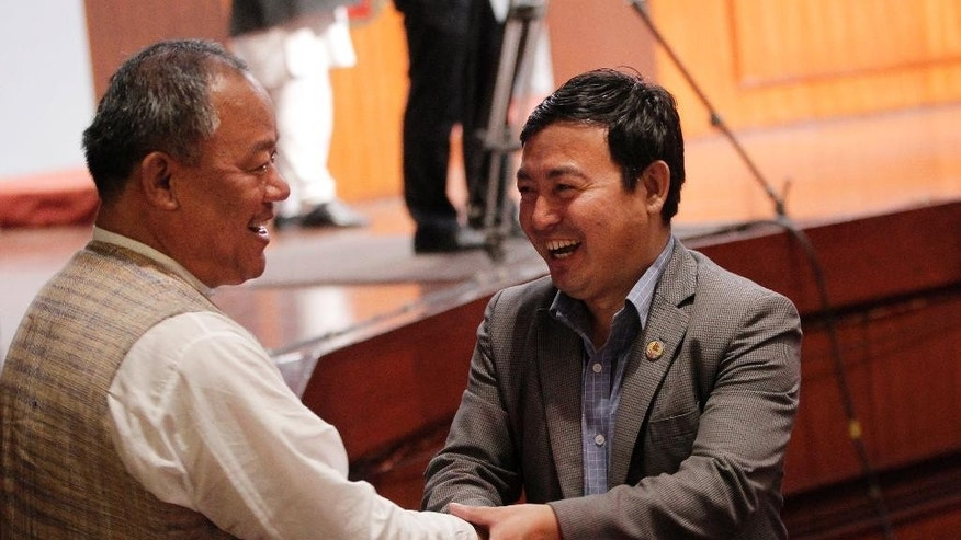 Nepalese lawmakers greet each other after the final constitution process at Constitution Assembly hall in Kathmandu, Nepal, Wednesday, Sept. 16, 2015. Nepal's Constituent Assembly has overwhelmingly approved a new constitution that has been delayed for years because of differences between political parties. (AP Photo/Niranjan Shrestha)