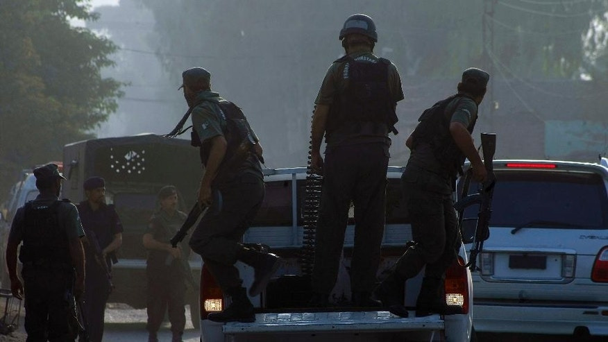Pakistani commandos arrive at an air force base in Peshawar, Pakistan, Friday, Sept. 18, 2015. Militants in northwestern Pakistan attacked an air force base on the outskirts of Peshawar early Friday, triggering a shootout that left at least 20 wounded and six of the attackers dead, officials said. (AP Photo/Mohammad Sajjad)