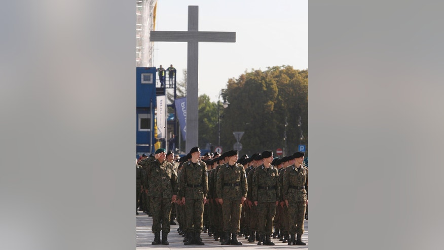 Members of pro-defense forces attend a parade in front of the Tomb of the Unknown Soldier in Warsaw, Poland, Thursday, Sept. 17, 2015, during the first nationwide rally. They have marched in downtown Warsaw to show their readiness to defend Poland if needed, amid concerns over the conflict in neighboring Ukraine and Russia's role in it. (AP Photo/Czarek Sokolowski)
