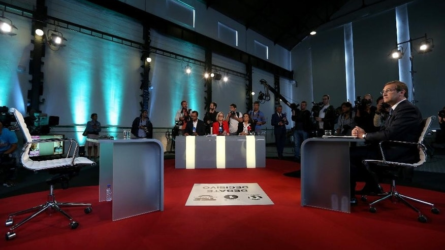 Portuguese Prime Minister Pedro Passos Coelho waits for the arrival of opposition Socialist Party leader Antonio Costa before their second debate in Lisbon, Thursday Sept. 17, 2015. Portugal will got to the polls to elect a new government on Oct. 4. (AP Photo/Steven Governo)