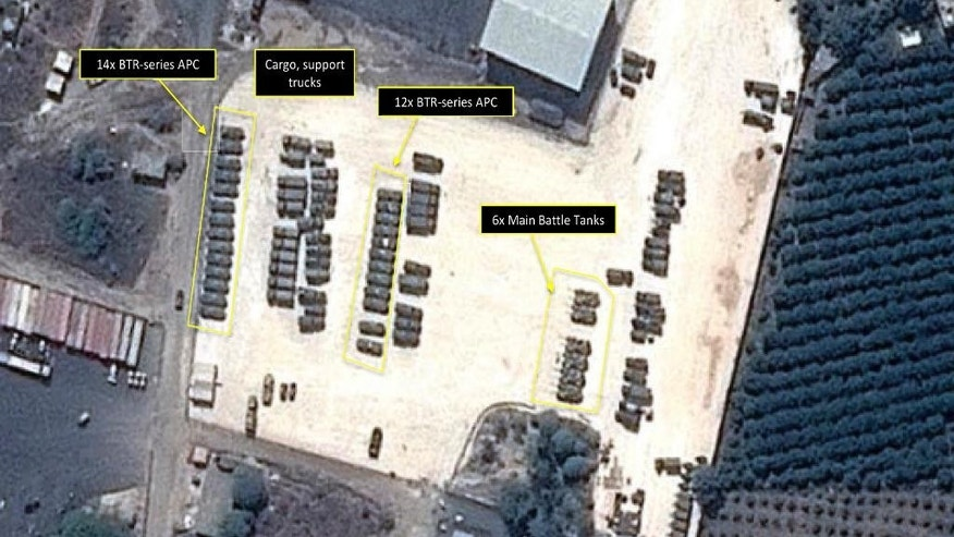 "This Tuesday, Sept. 15, 2015 satellite image with annotations provided by GeoNorth, AllSource Analysis, Airbus shows Russian tanks and armed personnel carriers at an air base in Latakia province, Syria. Russia on Thursday strongly urged the United States and its allies to engage the Syrian government as a ""partner"" in the fight against the Islamic State group, and offered to share any information about its military supplies to Damascus with Washington. (GeoNorth, AllSource Analysis, Airbus via AP)"