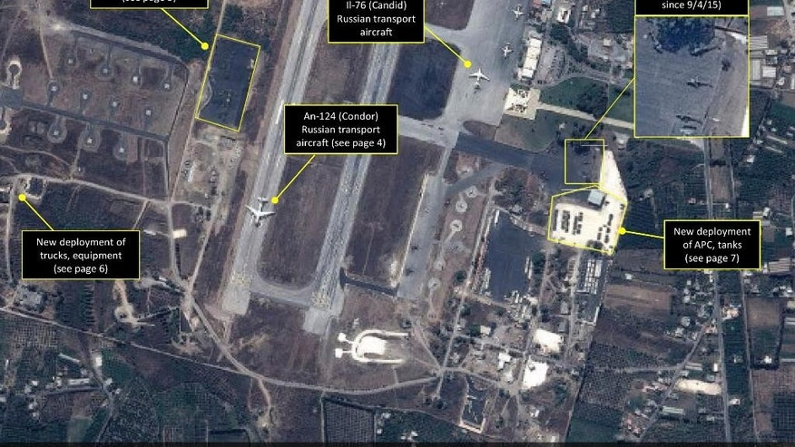 "This September 2015 satellite image with annotations provided by GeoNorth, AllSource Analysis, Airbus shows Russian transport aircraft, helicopters, tanks, trucks and armed personnel carriers at an air base in Latakia province, Syria. Russia on Thursday, Sept. 17, strongly urged the United States and its allies to engage the Syrian government as a ""partner"" in the fight against the Islamic State group, and offered to share any information about its military supplies to Damascus with Washington. (GeoNorth, AllSource Analysis, Airbus via AP)"