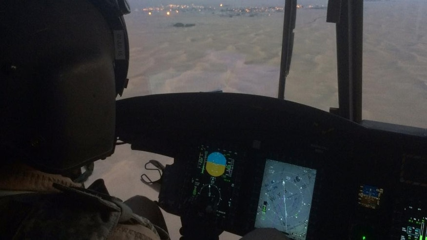 An Emirati pilot directs his Chinook helicopter toward a military base in Saffer, Yemen, Wednesday, Sept. 16, 2015. The Emiratis are part of thousands of Saudi Arabia and the United Arab Emirates forces fighting on the ground in Yemen to reverse the territorial gains by the Iran-backed rebels known as Houthis, who captured Sanaa last year and much of the country's north. (AP Photo/Adam Schreck)