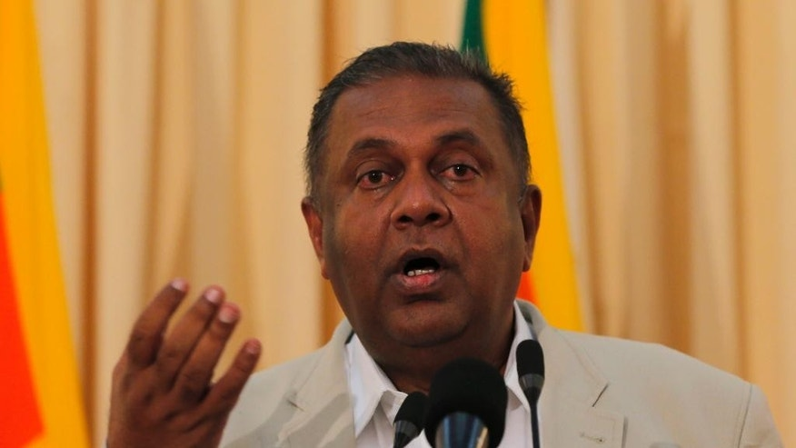 Sri Lankan Foreign Minister Mangala Samaraweera gestures as he speaks at a media briefing in Colombo, Sri Lanka, Thursday, Sept. 17, 2015. Samaraweera said Sri Lanka will begin talks next month on creating a special court to examine alleged atrocities during the country's civil war, in which tens of thousands of people died. (AP Photo/Eranga Jayawardena)