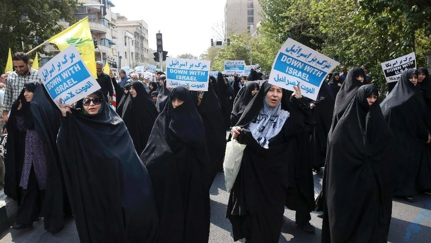 "Iranian women hold anti-Israeli placards while chanting slogans in a protest after Friday prayer service in Tehran, Iran, Friday, Sept. 18, 2015. Hundreds of worshipers staged an anti-Israeli protest for its response to Palestinians protest against unusual numbers of Jewish visitors at Al-Aqsa mosque compound in recent days. Chanting ""Death to Israel"" and ""Death to the U.S.,"" demonstrators condemned an ""Israeli invasion to Al-Aqsa"" mosque. State TV said similar protests were held in several other major Iranian cities. (AP Photo/Vahid Salemi)"