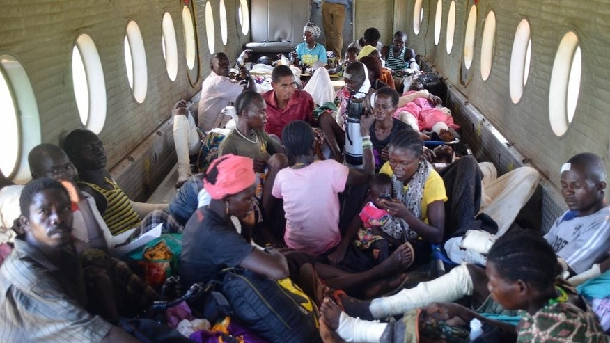 Burn victims and their relatives sit inside a plane as they are evacuated to the capital Juba for medical treatment, some of the many injured when a truck carrying petrol overturned Wednesday and then exploded shortly after hundreds of villagers had gathered around to siphon fuel, in Maridi, Western Equatoria State, South Sudan Friday, Sept. 18, 2015. The death toll from a fuel tanker explosion in the rural South Sudanese state reached 183 on Friday, a regional official said, as medical staff and volunteers struggled to keep up with the influx of severely burned patients. (AP Photo/Jason Patinkin)