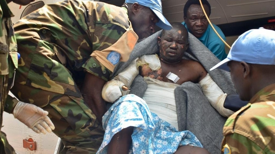 Rwandan UN peacekeepers evacuate a burn victim to the capital Juba by plane for medical treatment, one of many injured when a truck carrying petrol overturned Wednesday and then exploded shortly after hundreds of villagers had gathered around to siphon fuel, at the hospital in Maridi, Western Equatoria State, South Sudan Friday, Sept. 18, 2015. The death toll from a fuel tanker explosion in the rural South Sudanese state reached 183 on Friday, a regional official said, as medical staff and volunteers struggled to keep up with the influx of severely burned patients. (AP Photo/Jason Patinkin)