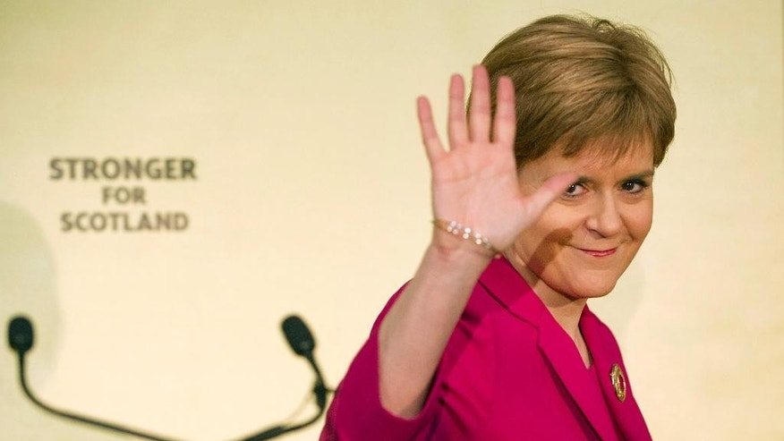 First Minister Nicola Sturgeon waves after giving a keynote speech one year on from Scotland's independence referendum at South Hall Complex in Edinburgh, Scotland, Friday Sept. 18, 2015.  A year after Scottish voters chose to remain in the United Kingdom, Scotland's leader says it would be wrong to rule out another independence referendum.  (Lesley Martin/PA via AP) UNITED KINGDOM OUT
