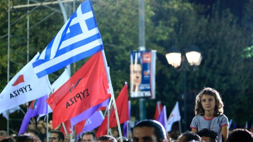 Supporters of Syriza left-wing party gather for the pre-election speech of former Prime Minister Alexis Tsipras at Syntagma square in Athens, Friday, Sept. 18, 2015. Opinion polls indicate a race too close to call, with Tsipras struggling to maintain the narrowest of leads over his main opponent, center-right New Democracy leader Vangelis Meimarakis. (AP Photo/Lefteris Pitarakis)