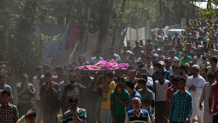 Kashmiri Muslim villagers carry the body of a 3-year-old boy during his funeral procession in Sagipora, some 75 kilometers (47 miles) northwest of Srinagar, Indian controlled Kashmir, Saturday, Sept. 19, 2015. Gunmen have shot and killed the 3-year-old boy and his father in Indian-controlled Kashmir, police said Saturday. (AP Photo/Dar Yasin)