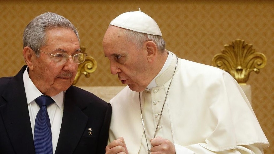 In this May 10, 2015 file photo, Pope Francis meets with Cuban President Raul Castro, left, during a private audience at the Vatican. Pope Francis begins a 10-day trip to Cuba and the United States on Saturday, Sept. 19, 2015 embarking on his first trip to the onetime Cold War foes after having helped nudge forward their historic rapprochement. (AP Photo/Gregorio Borgia, Pool, File)