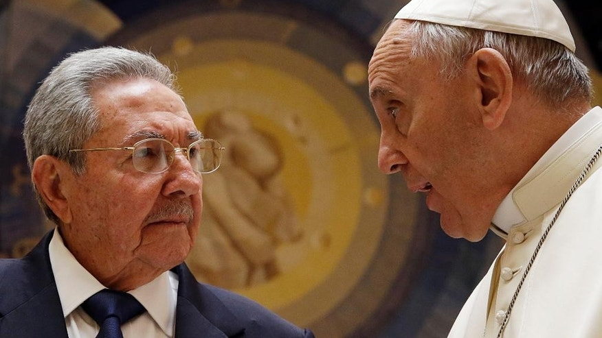 In this May 10, 2015 file photo, Pope Francis meets Cuban President Raul Castro, left, during a private audience at the Vatican. Pope Francis begins a 10-day trip to Cuba and the United States on Saturday, Sept. 19, 2015 embarking on his first trip to the onetime Cold War foes after having helped nudge forward their historic rapprochement. (AP Photo/Gregorio Borgia, Pool, File)
