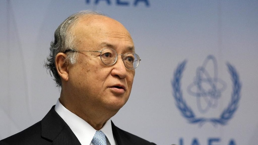 FILE - In this June 8, 2015 file photo, Director General of the International Atomic Energy Agency, IAEA, Yukiya Amano of Japan addresses the media during a news conference after a meeting of the IAEA board of governors at the International Center in Vienna, Austria. Iran said a Sunday, Sept. 20, 2015 visit by the U.N. nuclear chief to Tehran is aimed at implementing an agreement between Tehran and the UN nuclear watchdog according to the official IRNA news agency on Saturday. (AP Photo/Ronald Zak, File)