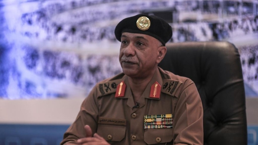 Saudi Interior Ministry spokesman Maj. Gen. Mansour al-Turki speaks during an interview with The Associated Press at a security monitoring center in Mecca, Saudi Arabia, Saturday, Sept. 19, 2015. (AP Photo/Mosa'ab Elshamy)