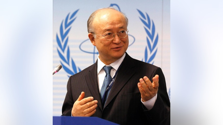 """File-This April 4, 2011, file photo shows Director General of the International Atomic Energy Agency, IAEA, Yukiya Amano from Japan speaking during a news conference of the IAEA's Parties to Nuclear Safety Convention Hold Review at the International Center in Vienna, Austria. The head of the U.N. nuclear agency is heading to Tehran for high-level meetings as he tries to accelerate his probe of allegations that Iran worked in the past on nuclear weapons. Fredrik Dahl of the U.N's International Atomic Energy Agency said that Amano's meetings Sunday, Sunday, Sept. 20, 2015, are aimed at """"clarifications of past and present outstanding issues"""" linked to the agency's probe. (AP Photo/Ronald Zak, File)"""