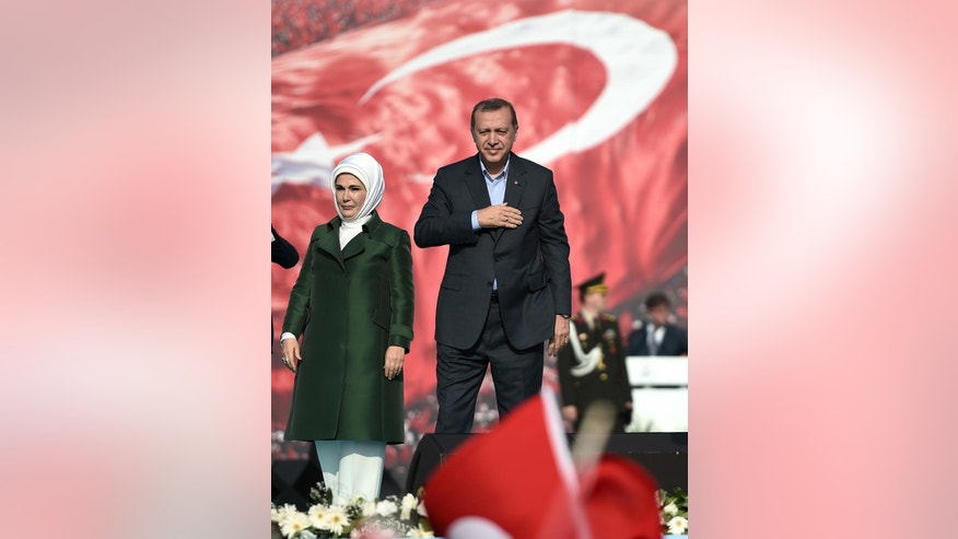 Turkey's President Recep Tayyip Erdogan and his wife Emine Erdogan salute cheering supporters, as tens of thousands of demonstrators rally to denounce violence by Kurdish rebels, in Istanbul, Turkey, Sunday, Sept. 20, 2015.. Speakers condemned terrorism and the violence which has rocked eastern Turkey since the resumption of fighting between the military and the Kurdistan Workers' Party, or PKK. The separatist group is considered a terror organization by the Turkey, the U.S. and the EU. (AP Photo)