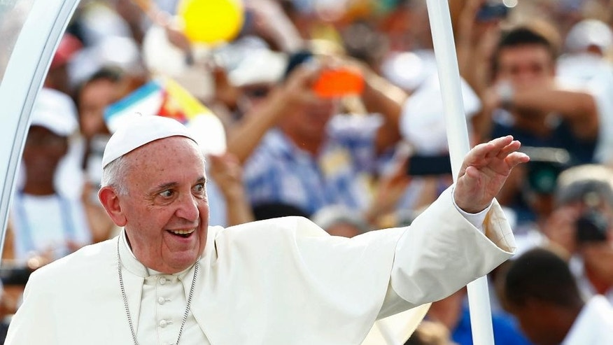 Pope Francis arrives to celebrate Mass in Revolution Square in Havana, Cuba, Sunday, Sept. 20, 2015. Pope Francis opens his first full day in Cuba on Sunday with what normally would be the culminating highlight of a papal visit: Mass before hundreds of thousands of people in Havana's Revolution Plaza.  (Tony Gentile/POOL via AP)
