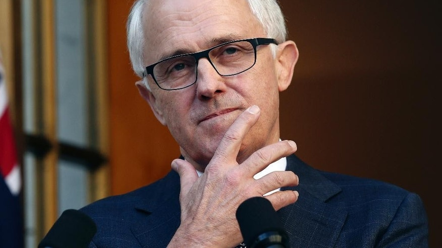 Australia Prime Minister Malcolm Turnbull gestures as he announces his new cabinet during a press conference at Parliament House in Canberra, Australia, Sunday, Sept. 20, 2015. Turnbull announced sweeping changes to his first Cabinet and promoted more women from two to five, including Australia's first female Defense Minister Marise Payne. (AP Photo/Rob Griffith)