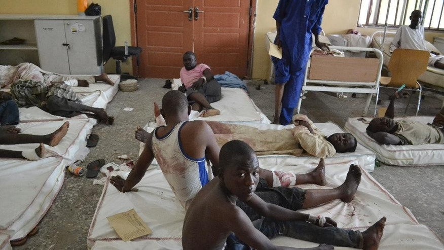 Victims receive treatment at a hospital, after an explosion in Maiduguri,  Nigeria Monday, Sept. 21, 2015. Extremists detonated three explosive devices on Sunday in Maiduguri, the capital of Borno state, in Nigeria's northeast, a military official said Sunday.  (AP Photo/Jossy Ola)
