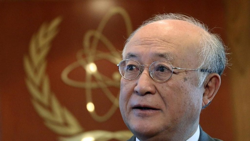 "FILE - In this May 12, 2015 file photo, U.N. nuclear chief  Yukiya Amano from Japan speaks during an interview with The Associated Press in Vienna, Austria. Iran's state TV is reporting Amano has arrived in Tehran Saturday, Sept. 20, 2015, to ""clarify past and current issues"" of the country's nuclear program. Iran and the world powers have agreed to a landmark deal that curbs Iran's nuclear program in return for the lifting of international economic sanctions. (AP Photo/Ronald Zak, File)"