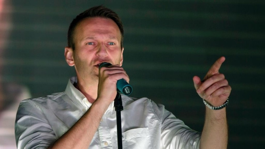 Russian opposition activist Alexei Navalny addresses an opposition rally in Moscow, Russia, Sunday, Sept. 20, 2015. Russia's opposition rallied in an outlying Moscow neighborhood to decry the rule of President Vladimir Putin. (AP Photo/Pavel Golovkin)