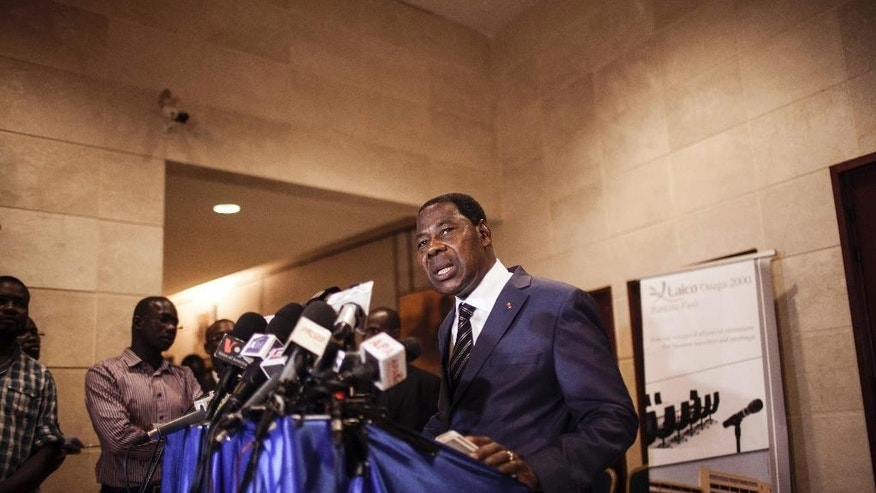 In this photo taken on Saturday, Sept. 19, 2015, Benin President Thomas Boni Yayi speaks to media as he had talks with Gen. Gilbert Diendere, who was named leader of Burkina Faso on Thursday, in Ouagadougou,  Burkina Faso. West African mediators late Saturday hinted at a breakthrough in Burkina Faso's political crisis after a military coup brought a general to power less than a month before scheduled elections.  (AP Photo/Theo Renaut)