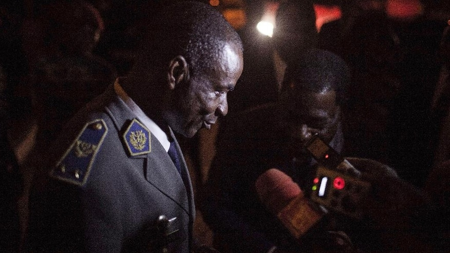 In this photo taken on Saturday, Sept. 19, 2015, Gen. Gilbert Diendere, left, who was named leader of Burkina Faso on Thursday, speaks to media in Ouagadougou, Burkina Faso. West African mediators late Saturday hinted at a breakthrough in Burkina Faso's political crisis after a military coup brought a general to power less than a month before scheduled elections. (AP Photo/Theo Renaut)