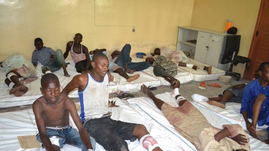 Sept. 21, 2015 - Victims receive treatment at a hospital, after an explosion in Maiduguri, Nigeria. Extremists detonated 3 explosive devices in Maiduguri, a military official said Sunday.