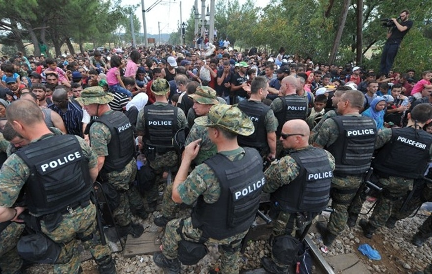 Police in Macedonia hold back hordes of refugees hoping to pass through the Balkans en route to Western Europe. (FoxNews.com)