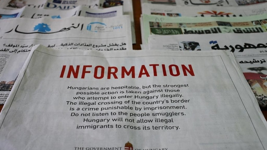 A full-page advertisement by the Hungarian government that was published in Lebanese newspapers, warning migrants not to enter the country illegally saying it is a crime punishable by imprisonment, in Beirut, Lebanon, Monday, Sept. 21, 2015. Hungary, which closed its border with Serbia on Sept. 15, erected another steel barrier at the Beremend border crossing from Croatia to try to slow the flow of migrants. But they kept coming. Lebanon has nearly 1.2 million Syrian refugees some of whom have expressed interest in migrating to Europe because of poor conditions they live in here. (AP Photo/Hussein Malla)
