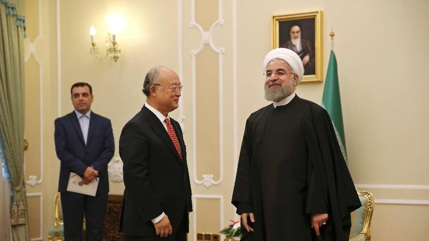 Sept. 20, 2015 - Iranian President Hassan Rouhani, right, welcomes U.N. nuclear chief Yukiya Amano for meeting in Tehran, Iran. Rouhani told Amano his agency should be fair in its implementation of a nuclear deal reached between Iran and the world powers, according to a report on Rouhani's website.
