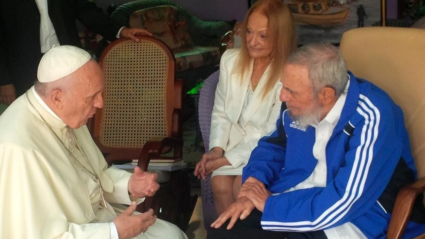 In this photo taken on Sunday, Sept. 20, 2015 Pope Francis talks to Cuba's Fidel Castro, in Havana, Cuba. The Vatican described the 40-minute meeting at Castro's residence as informal and familiar, with an exchange of books. (L'Osservatore Romano/Pool Photo via AP)