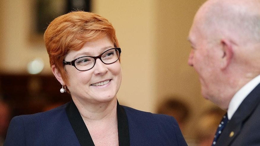 Australia's first female Minister for Defense Marise Payne talks with Governor-General Peter Cosgrove during the swearing-in ceremony of Prime Minister Malcolm Turnbull's cabinet at Government House Monday, Sept. 21, 2015 in Canberra, Australia. (Stefan Postles/Pool Photo via AP)