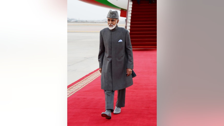 FILE - In this undated file photo made available on Monday, March 23, 2015, by Oman News Agency, Sultan Qaboos bin Said of Oman arrives in Muscat, Oman. Oman's announcement on Sunday, Sept. 20, 2015, that it negotiated the release of foreign hostages held by Yemen's Shiite Houthi rebels is the most recent example of the unassuming sultanate wielding its influence as one of the Middle East's most useful mediators of thorny disputes. (Oman News Agency via AP, File)