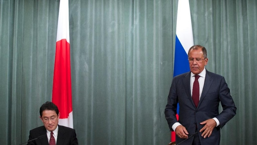 Russian Foreign Minister Sergey Lavrov, right, and his Japan's counterpart Fumio Kishida leave a news conference after their talks in Moscow, Russia, on Monday, Sept. 21, 2015. (AP Photo/Ivan Sekretarev)