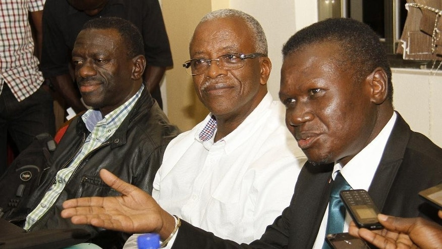 In this photo taken Friday, Sept. 18 , 2015, Uganda opposition leaders, from left to right: Forum for Democratic Change, Dr. Kizza Besigye, former Prime Minister Amama Mbabazi and Democratic Party President Norber Mao meeting at the Democratic Alliance office in Kampala.  The leaders of Uganda's main opposition parties are meeting Monday Sept. 21, 2015  in talks aimed at fronting a joint candidate to challenge the country's long-serving leader in elections next year.  (AP Photo)