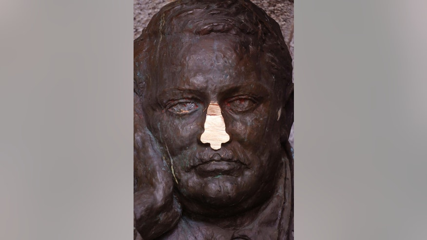 A statue of British colonialist Cecil Rhodes, with it's nose vandalized in the  Table Mountain National Park near the city of Cape Town, South Africa, Monday, Sept. 21, 2015. The bronze bust of British colonialist Cecil Rhodes lost its nose to vandals on Friday Sept. 18, 2015, who severed it with a power tool at a South African mountain slope overlooking Cape Town .  (AP Photo/Schalk van Zuydam)