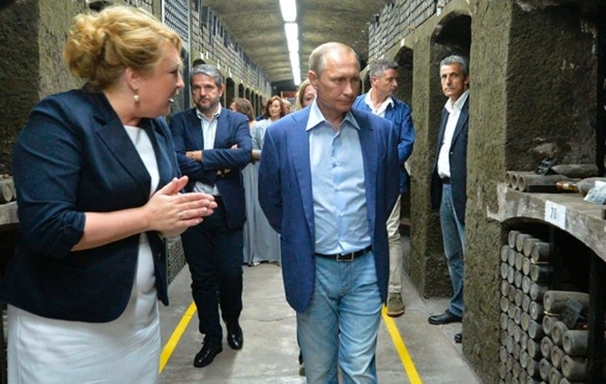 Russian President Vladimir Putin, right, visits the state-owned Massandra winery in Yalta, Crimea, Friday, Sept. 11, 2015. President Putin arrived in Crimea to meet with Former Italian Prime Minister Silvio Berlusconi. The Massandra Collection is one of the largest and truly unique collections of fine and rare wines in the world, estimated at over one million bottles, of various types and vintages which are recorded into the Guinness Book of Records. (Alexei Druzhinin/RIA-Novosti, Kremlin Pool Photo via AP)