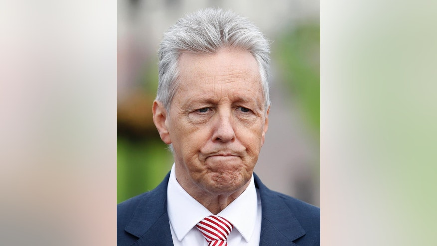 Democratic Unionist Party leader Peter Robinson pauses during a press conference at Stormont, Belfast, Northern Ireland, Monday, Sept. 21, 2015. The five main political parties met Monday with party-talks being aimed at resolving the current crisis threatening the power sharing institutions. (AP Photo/Peter Morrison)