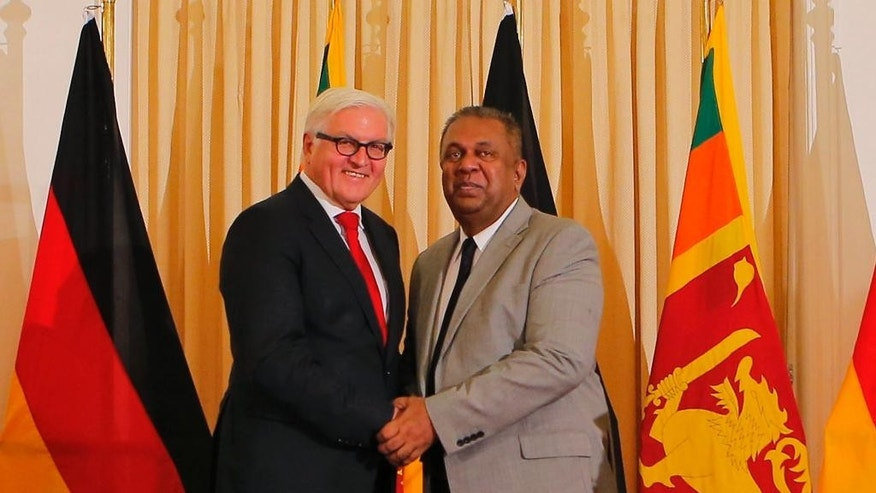Sri Lankan Foreign Minister Mangala Samaraweera, right, and his German counter part Frank-Walter Steinmeier shake hands after their meeting in Colombo, Sri Lanka, Tuesday, Sept. 22, 2015. Steinmeier is on a official visit to Sri Lanka. (AP Photo/Eranga Jayawardena)