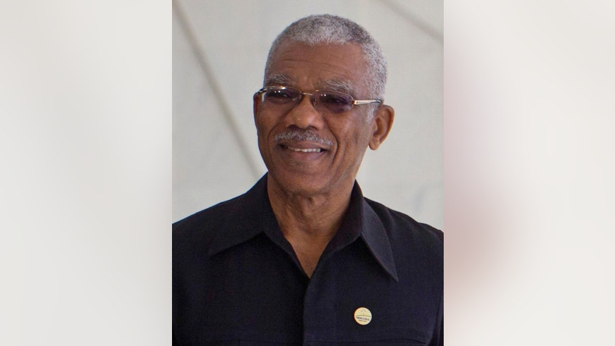 "FILE - In this July 17, 2015 file photo, Guyana's President David Granger poses for a photo in Brasilia, Brazil. On Tuesday, Sept. 22, 2015, Granger has accused Venezuela of deploying troops to a contested border region in what he called a ""dangerous"" escalation of a long-running dispute between the two South American nations. (AP Photo/Joedson Alves, File)"