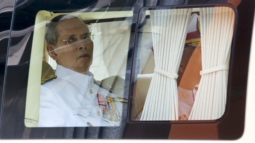 May 5: King Bhumibol Adulyadej sits in a vehicle as he leaves Siriraj Hospital for the Grand Palace to join a ceremony marking Coronation Day in Bangkok, Thailand.