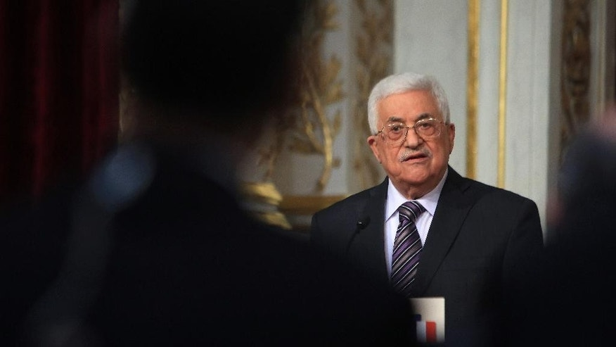 Palestinian President Mahmoud Abbas gives a press conference with French Peresident Francois Hollande, at the Elysee Palace, in Paris, France, Tuesday, Sept. 22, 2015. (AP Photo/ Thibault Camus)