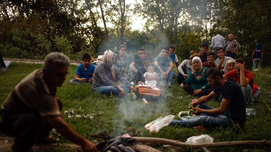 Hundreds of migrants rest as they wait to march down a highway towards Turkey's western border with Greece and Bulgaria, in Edirne, Turkey, Monday, Sept. 21, 2015. The migrants were stopped Friday by Turkish law enforcement on a highway near the city of Edirne, causing a massive traffic jam.(AP Photo/Emrah Gurel)